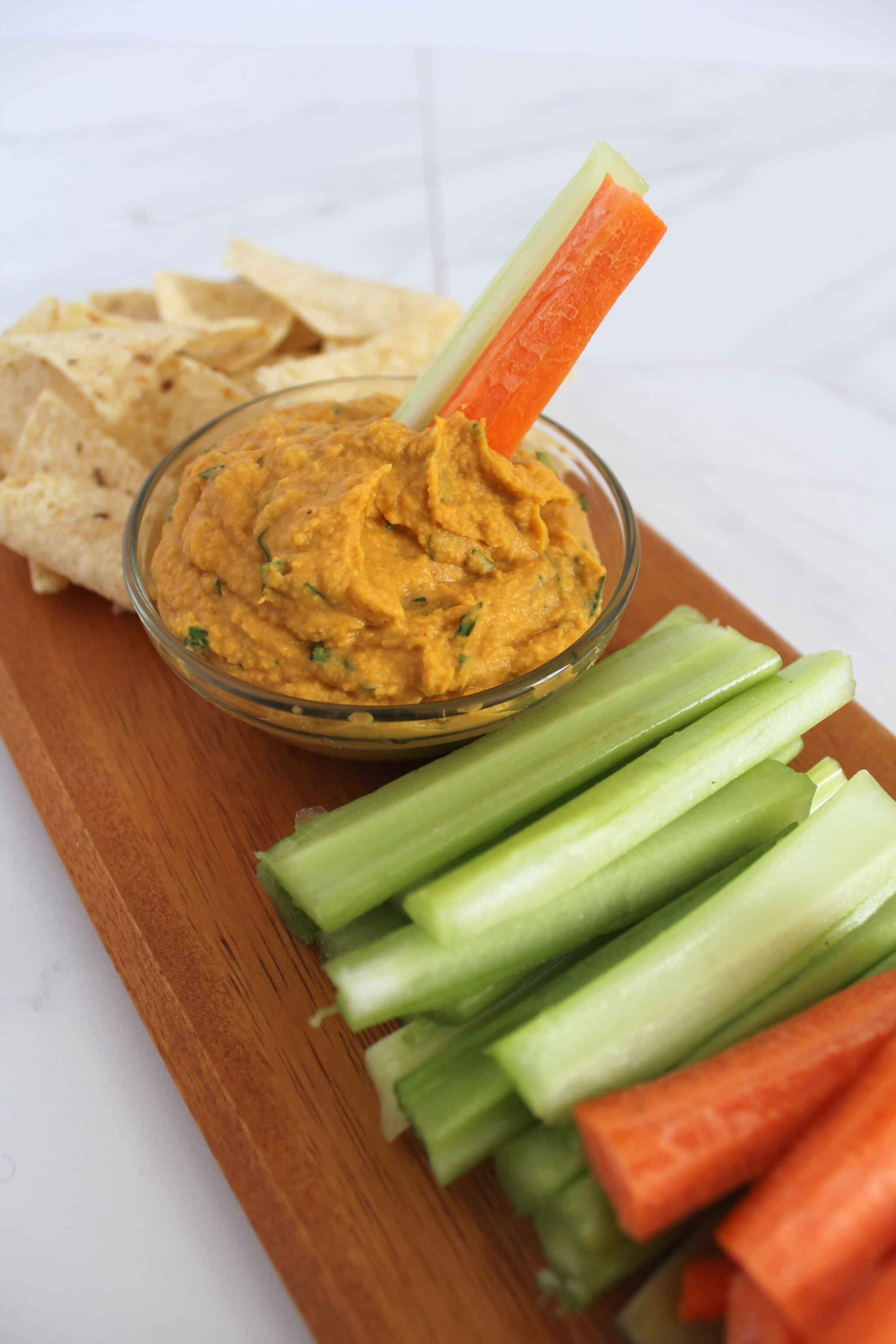 Thai Hummus Recipe with Pumpkin and vegetables on cutting board