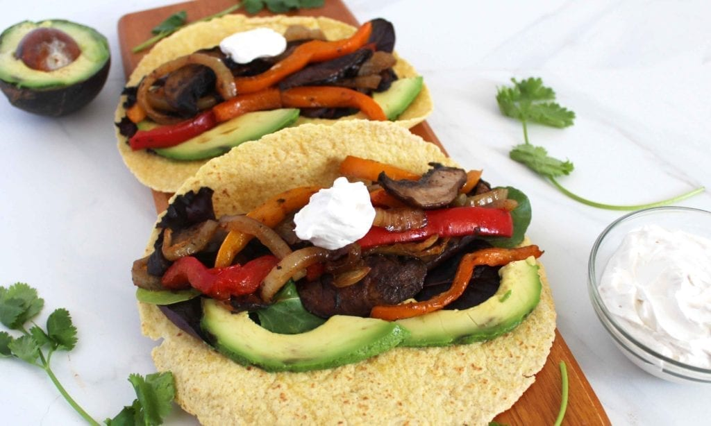 Oven baked and marinated vegan fajitas served with vegan sour cream