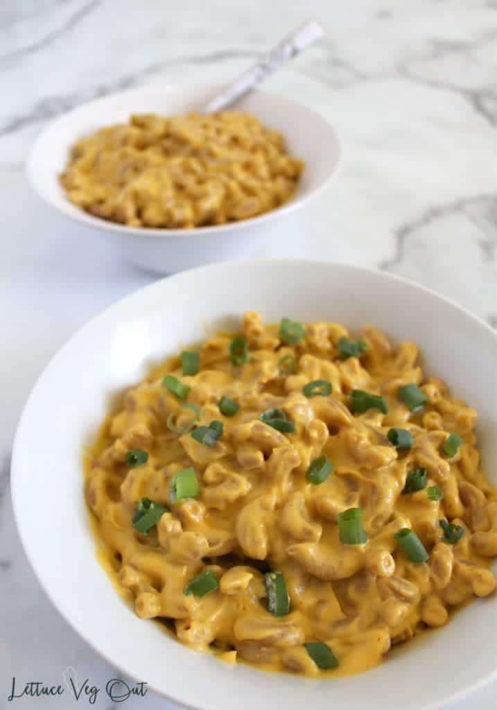 Vegan cauliflower cheese sauce in white bowl of macaroni