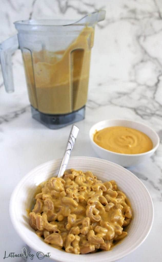 Vegan cheese sauce on pasta with blender of sauce