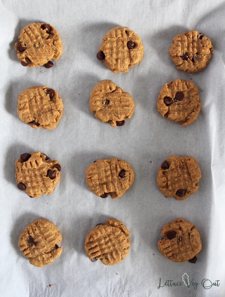 Baked peanut butter cookies with banana on a tray