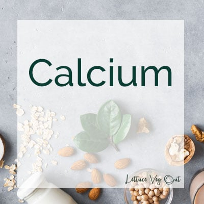 Calcium text over grey tile background with vegan calcium sources laid out (plant-based milk, almonds, soy)