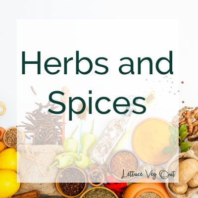 Herbs and spices text over background of a variety of herbs, spices and other food flavours on a white board
