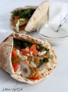Two vegan donair wraps with donair sweet sauce in small glass bowl