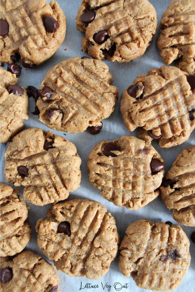 Cluster of peanut butter banana and peanut butter cookies on tile background
