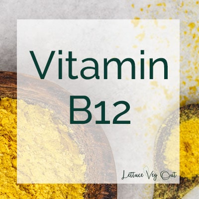 Vitamin B12 text over a background of nutritional yeast in a wooden bowl and spoon