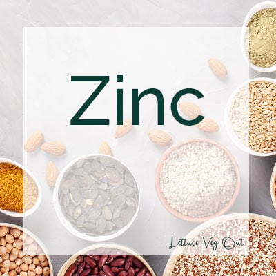 Zinc title image with background of vegan zinc sources in small bowls (seeds, whole grains, nuts)