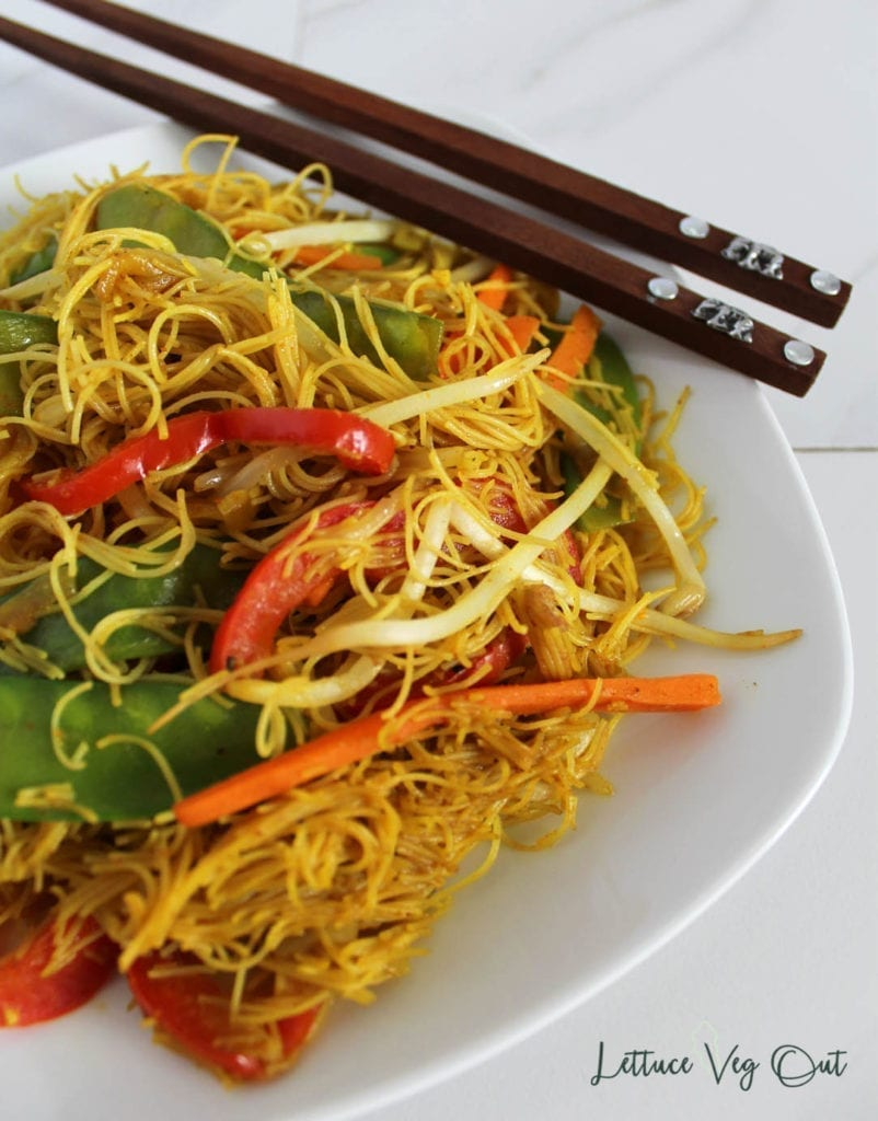 Plate of healthy Singapore noodles on white plate with chopsticks