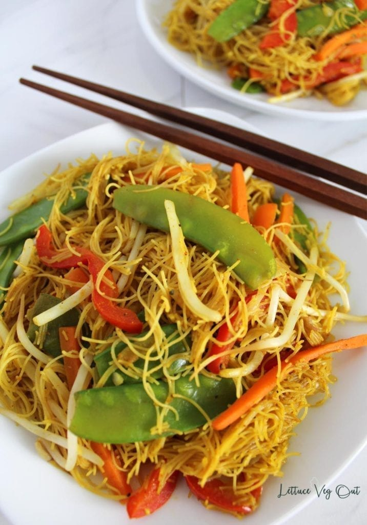 Close up of plate with vegetable curry vermicelli noodles