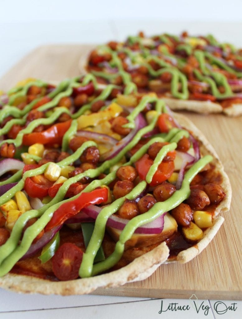 High protein vegan pizza toppings on pita bread pizza with vegan avocado pizza sauce