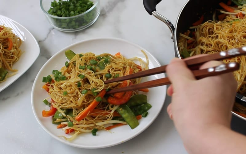 Image of served gluten free, vegan singapore noodles on a round white plate