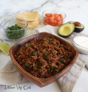 TVP tacos meat recipe in wooden bowl with taco filling options in background