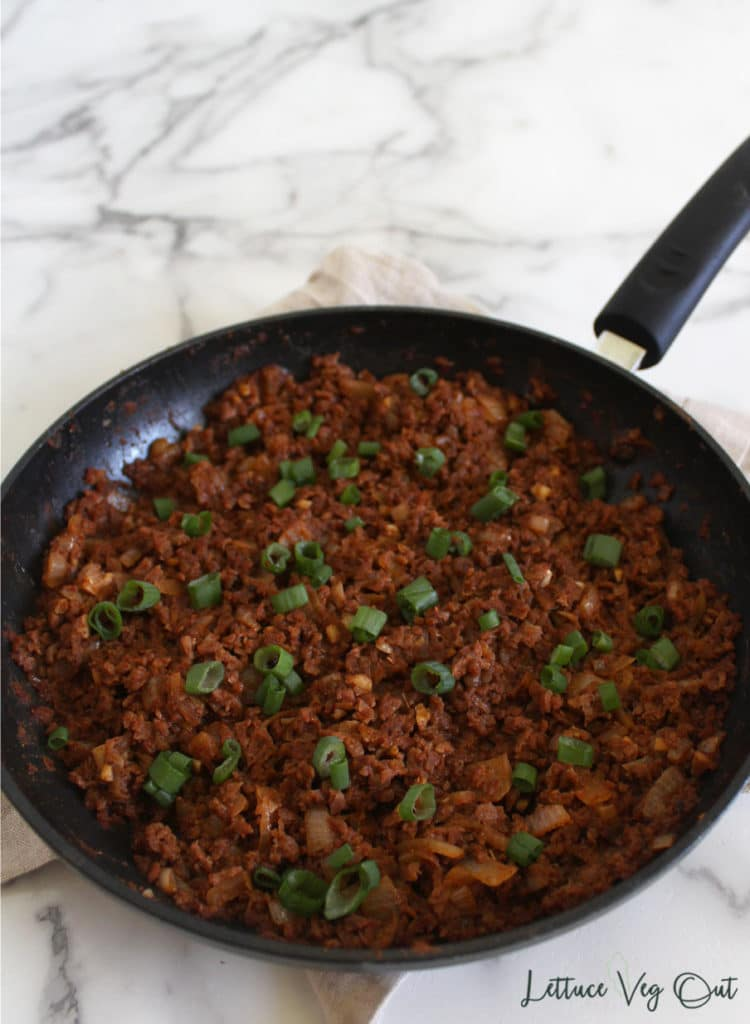 Large pan of TVP taco meat on marble background