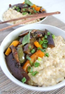 Bowl of Thai spicy eggplant stir fry with coconut milk brown rice