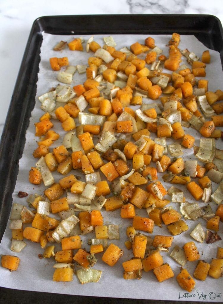 Tray of roasted butternut squash, onion and garlic