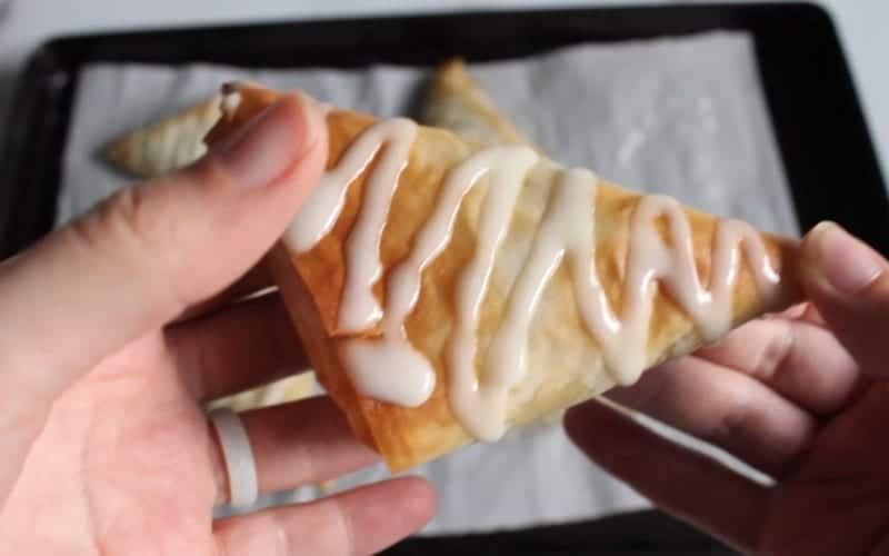 Image of icing drizzle on dairy free apple turnover; ready to eat