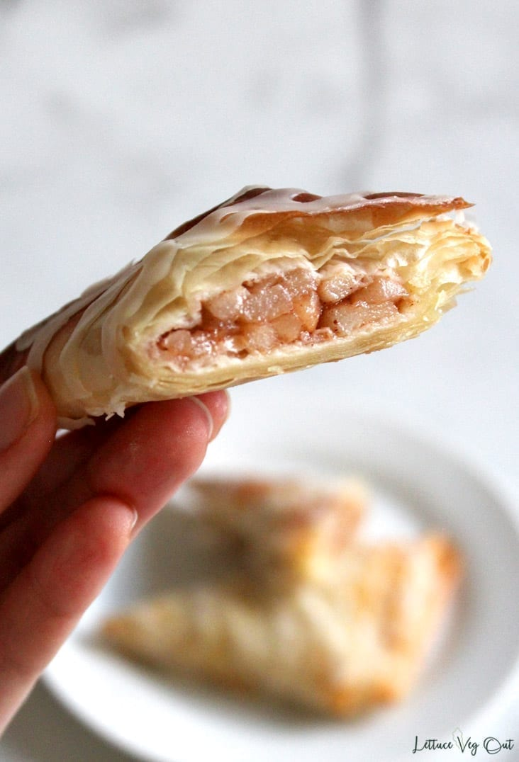 Close-up image of vegan apple turnover cut open to show eggless, dairy free apple filling
