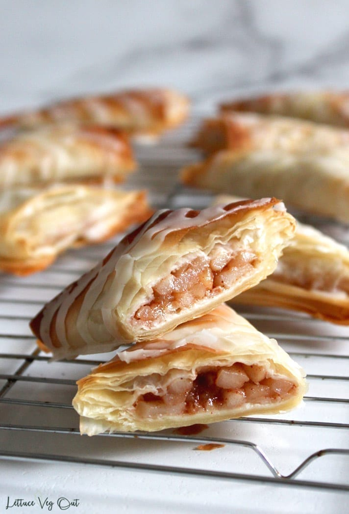 Image of cut open dairy free apple turnover on a cooling rack