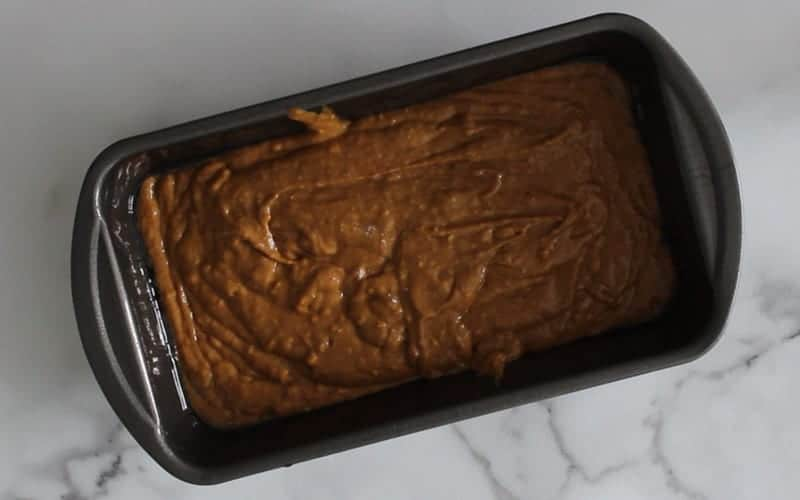 Vegan gingerbread loaf batter in baking pan, ready for heated oven
