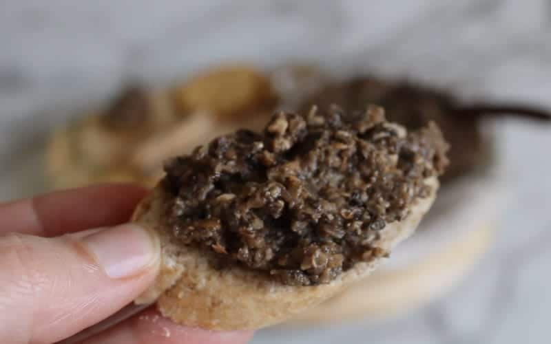 Vegan mushroom pate recipe served on a baguette slice