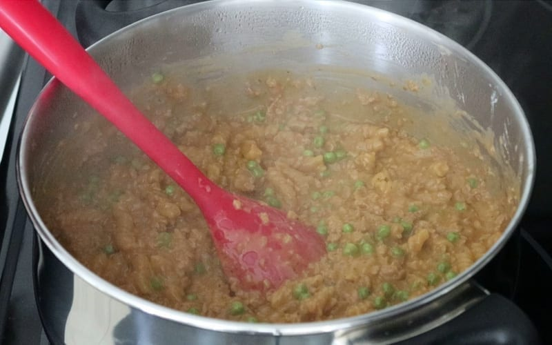 A pot of cooked vegan hamburger helper, ready to serve and eat