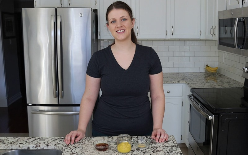Ingredients needed to make vegan honey mustard, including maple syrup, yellow mustard and garlic powder