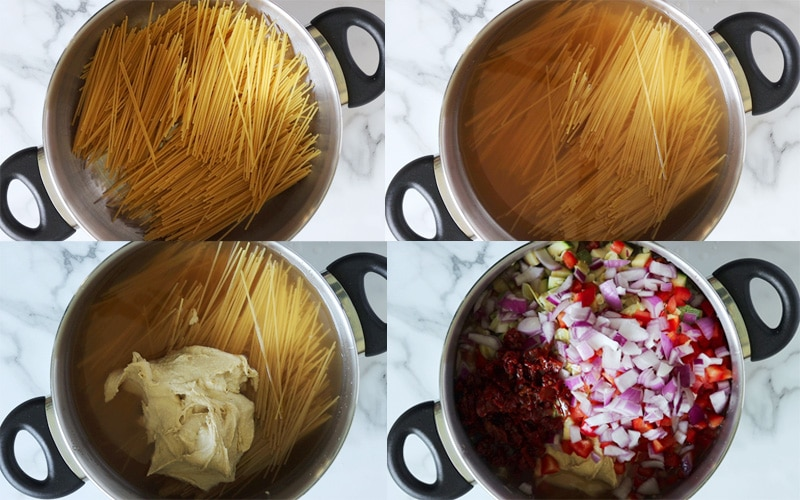 Compilation of 4 images each showing a large metal pot with black handles. Each image shows a progression of adding ingredients to the pot. From top left going right then down: raw spaghetti pasta fills the pot; liquid has been added to the raw pasta; a pile of hummus has been added; many chopped vegetables have been added (zucchini, red bell pepper, artichoke, red onion and sun dried tomato)