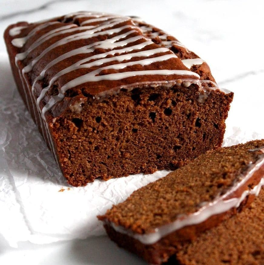 Vegan gingerbread loaf recipe with icing drizzle; eggless and dairy free dessert