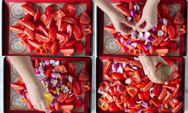 Compilation of 4 images showing the stages of prepping vegetables for roasting on a baking tray. From top left working right then down: chopped tomato and red pepper on the baking tray; red onion added to the tray with hands breaking apart the onion layers; garlic added to the tray and a hand is pouring olive oil onto the vegetables; vegetables tossed in oil while a hand sprinkles black pepper onto the vegetables.